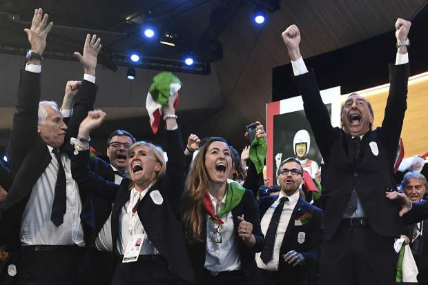Members of Milan-Cortina delegation celebrate after winning the bid to host the 2026 Winter Olympic Games, during the first day of the 134th Session of the International Olympic Committee (IOC), at the SwissTech Convention Centre, in Lausanne, Switzerland on June 24.