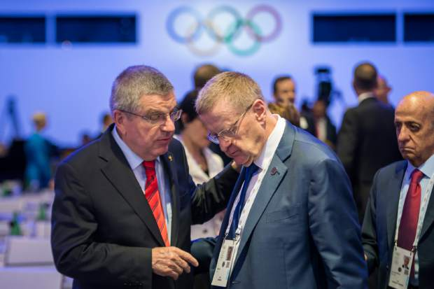 International Olympic Committee, IOC, President Thomas Bach from Germany, left, speaks with Australian IOC member John Coates, right, during the 134th Session of the International Olympic Committee (IOC), at the SwissTech Convention Centre, in Lausanne, Switzerland on June 25.