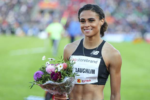 FILE - In this June 13, 2019, file photo, Sydney McLaughlin of the United States poses after winning women's 400m hurdles event at the IAAF Diamond League athletics competition in Oslo, Norway. About to turn 20 next month, she's juggling quite a few things these days _ new coach, living on the West Coast, making the transition from college to the pro circuit and the weight of lofty expectations. Her name constantly surfaces among the ones to watch heading into the Tokyo Games next summer.(Lise Aserud/NTB Scanpix via AP, File)