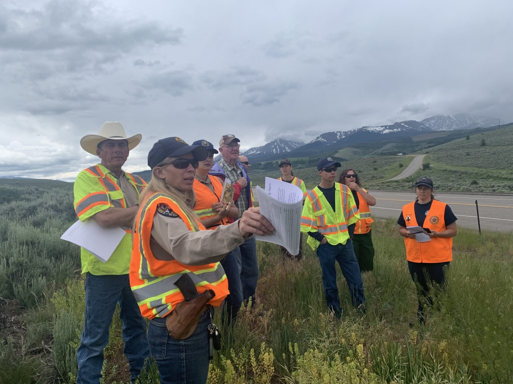 Elissa Slezak, Colorado Parks and Wildlife Northwest Region land-use specialist, discusses the terrain and possibilities for wildlife passages with a group of Summit County Safe Passages partners and stakeholders July 8 at the northern end of Green Mountain Reservoir.