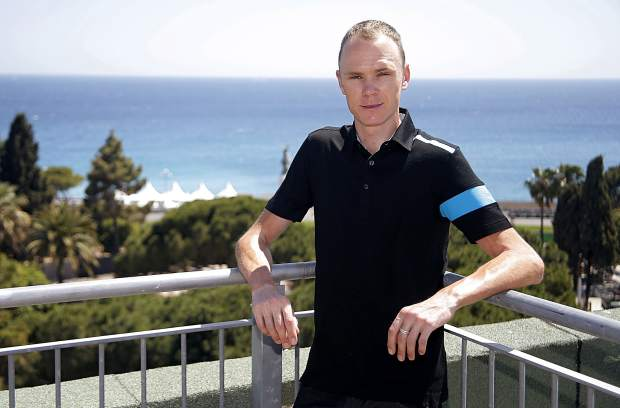 Cyclist Chris Froome of Team Sky poses for photographers before a meeting with journalists in Nice, southern France in 2013.