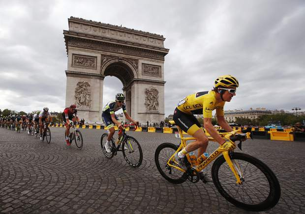 2018 Tour de France champion Geraint Thomas of Britain, wearing the overall leader's yellow jersey, passes the Arc de Triomphe during the twenty-first stage of the Tour de France cycling race last July.