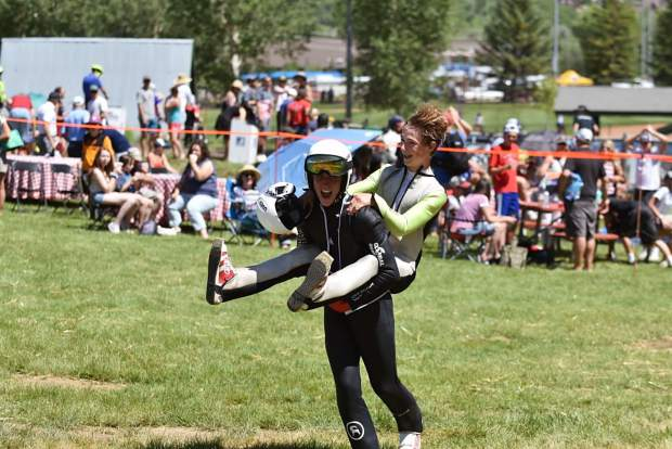 Two-time defending Jumpin' and Jammin' champion Decker Dean celebrates with Steamboat Springs native and 2019 victor Erik Belshaw at the base of Howelsen Hill on Thursday, July 4.