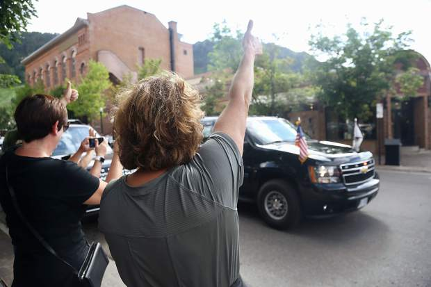 Vice President Mike Pence leaves the Caribou Club in downtown Aspen as supporters wave to him from the street corner on Monday, July 22, 2019. (Photo by Austin Colbert/The Aspen Times)