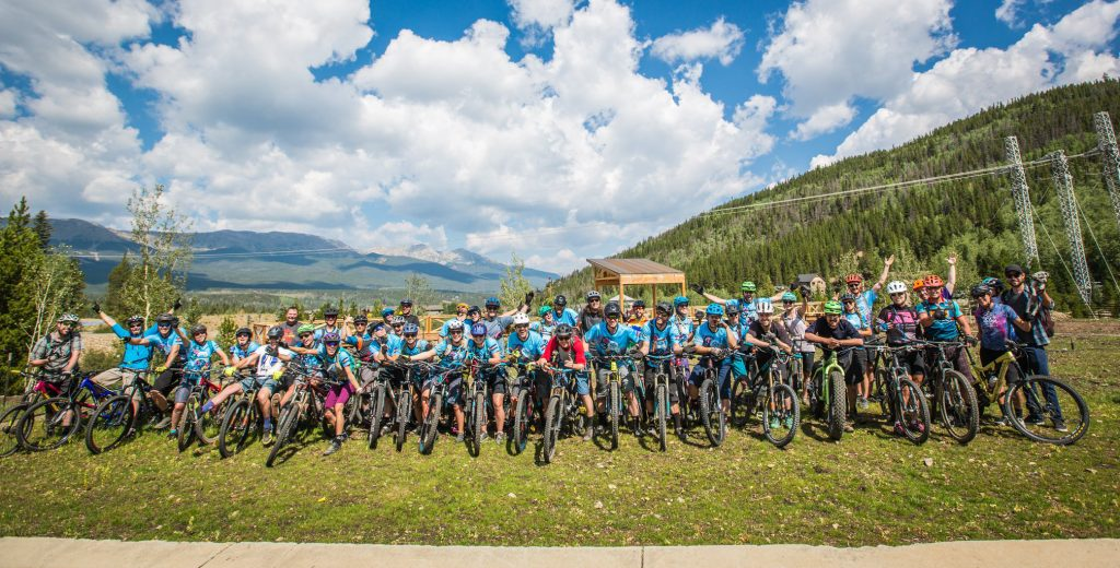 Friends of the late Breckenridge local Eric Dube take a group photo during their group-ride last summer in honor of Dube.