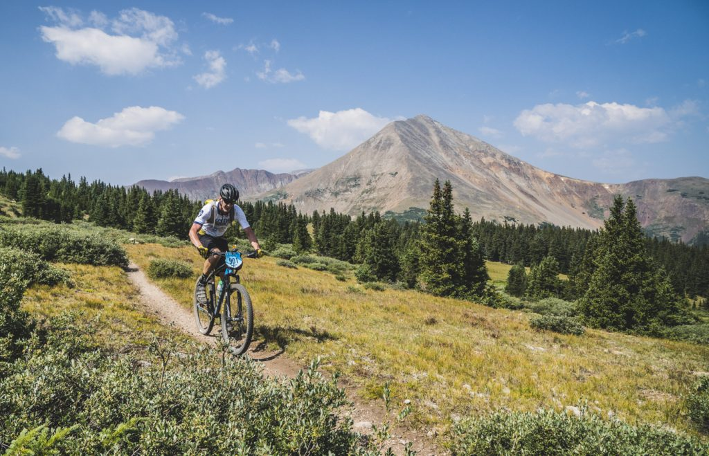 Mike Melley pedals during last year's third stage of the six-day mountain bike race, the circumnavigation of Mount Guyot.