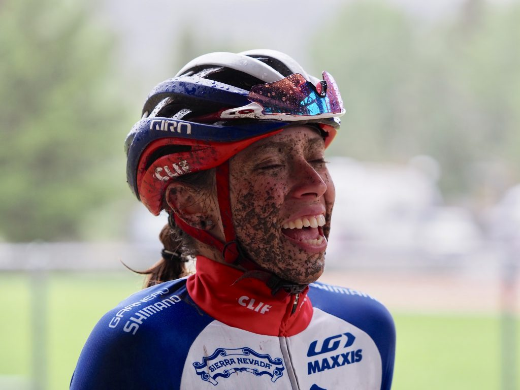 Hannah Finchamp of Salt Lake City smiles through the mud after taking second place among women at Sunday's first stage -- the 36-mile Pennsylvania Creek -- of the 6-day Breck Epic multi-day mountain bike race.