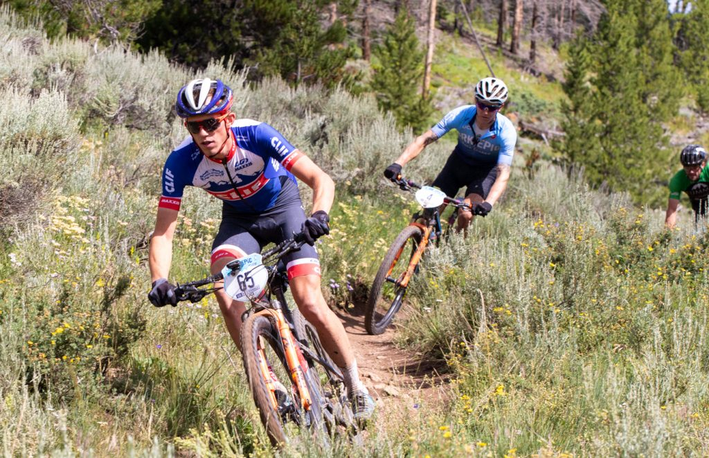 Russell Fintsterwald leads Keegan Sweson during a portion of singletrack riding during Monday morning's second stage of the Breck Epic week-long mountain bike race, the Colorado Trail.
