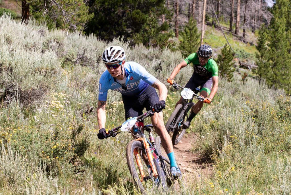 Keegan Swenson pedals head of Ryan Standish during Monday morning's Colorado Trail second stage in the week-long Breck Epic mountain bike race. Standish finished top-3 in the stage to improve his overall position.