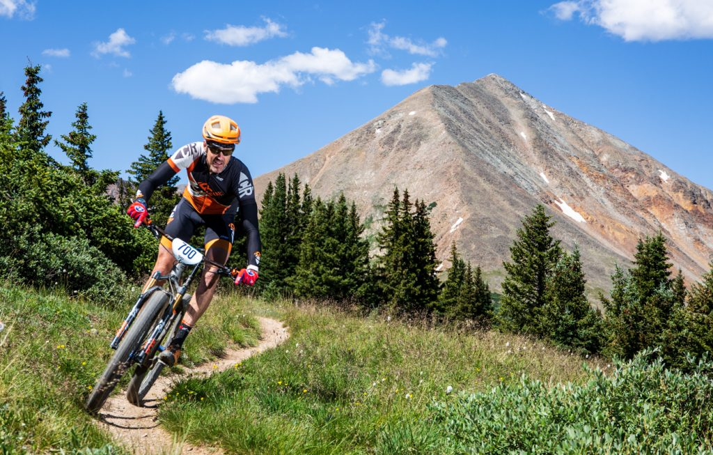 Brad Keyes rides singletrack, with Mount Guyot in view in the background, during Tuesday's third stage of the 6-day Breck Epic mountain bike race.