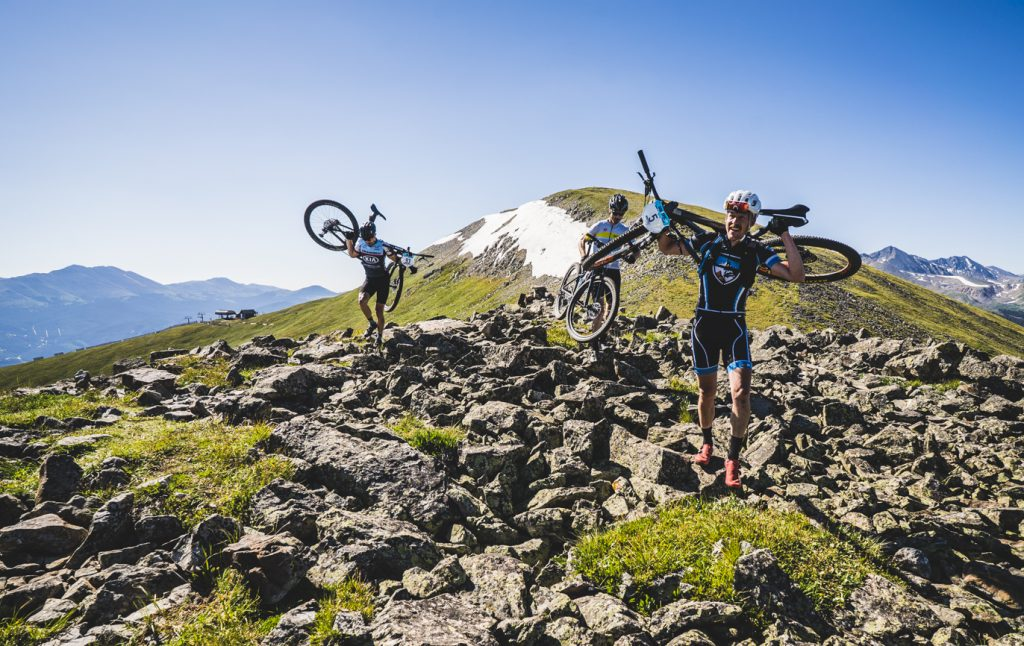 Mountain bikers hike with their bikes during the grueling traverse of the Tenmile Range A mountain biker takes a rest during the grueling ascent up the Tenmile Range as part of Thursday's fifth stage of the six-day Breck Epic mountain bike race.