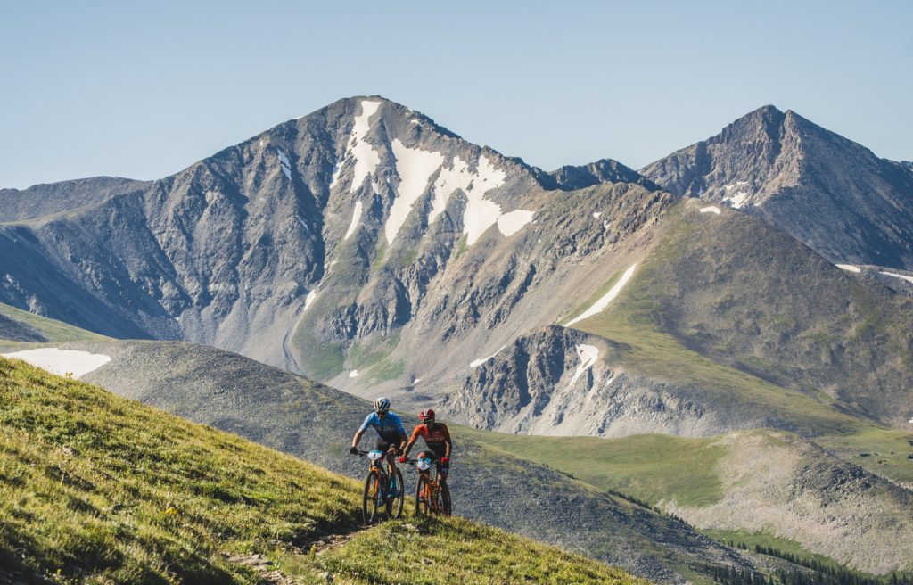 Men's race leader Keegan Swenson and Luis Mejia climb during the grueling ascent of the Tenmile Range to Wheeler Pass as part of August 2019's fifth stage of the six-day Breck Epic mountain bike race.