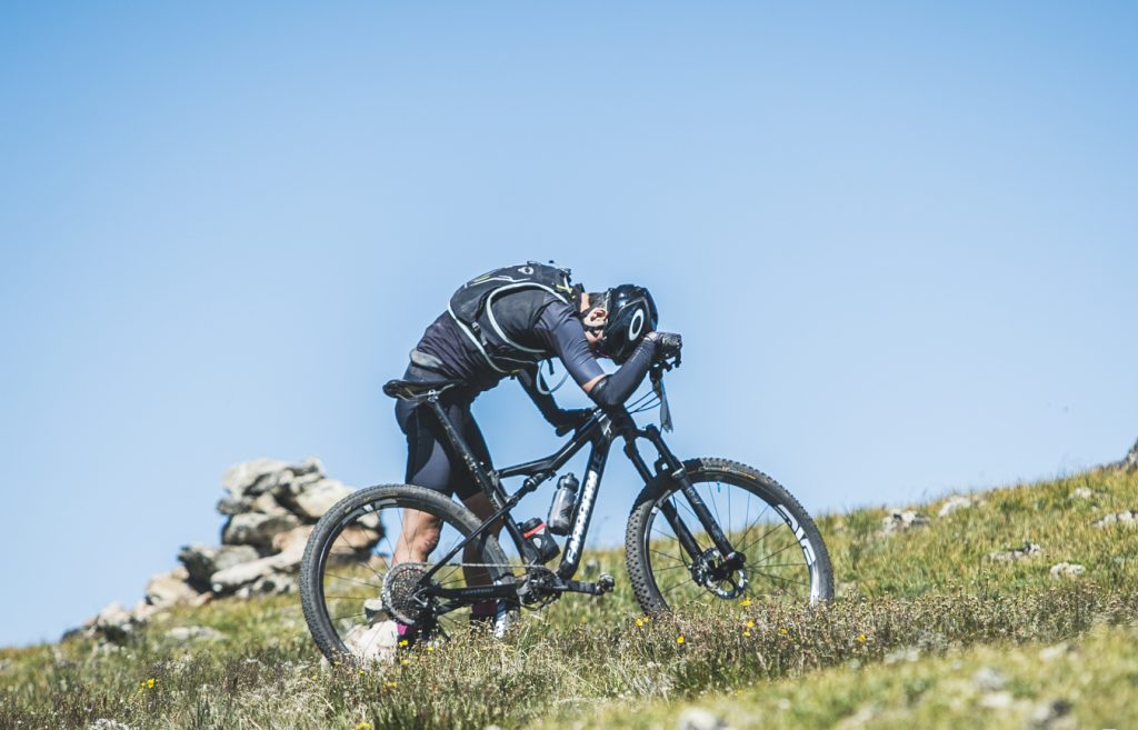 A mountain biker takes a rest during the grueling ascent up the Tenmile Range to Wheeler Pass as part of Thursday's fifth stage of the six-day Breck Epic mountain bike race.