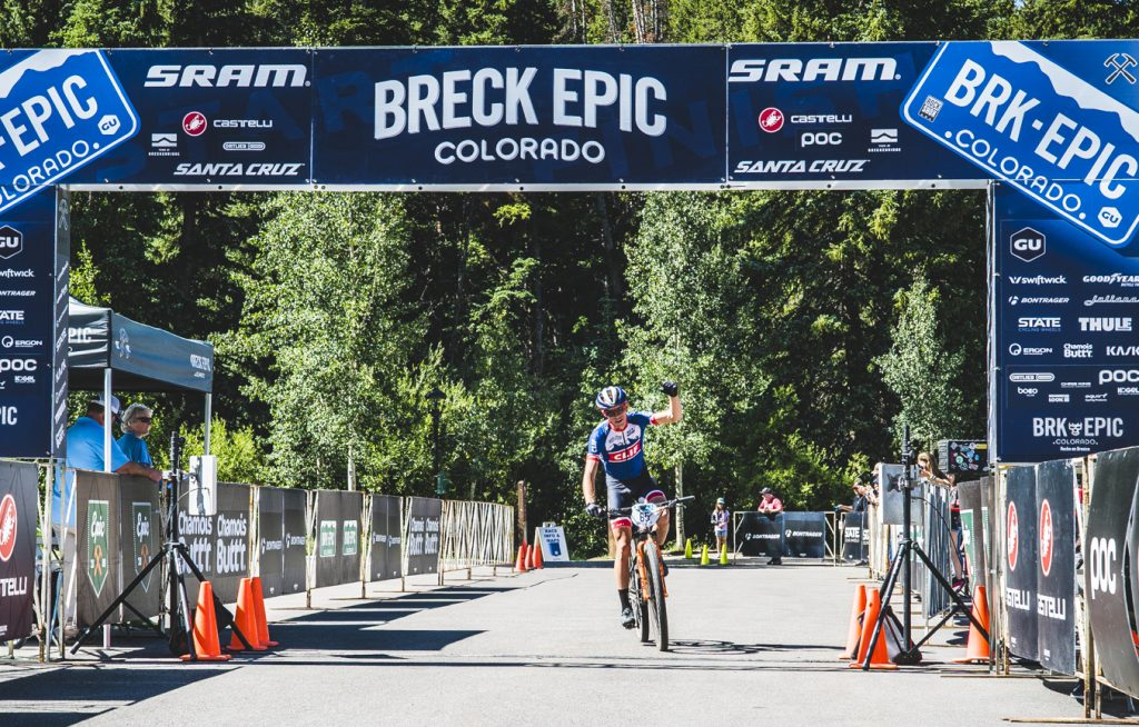 Park City native Keegan Swenson rides through the final stage's finish line on Friday to win the Union Cycliste Internationale elite men's division at the 6-day Breck Epic mountain bike race.
