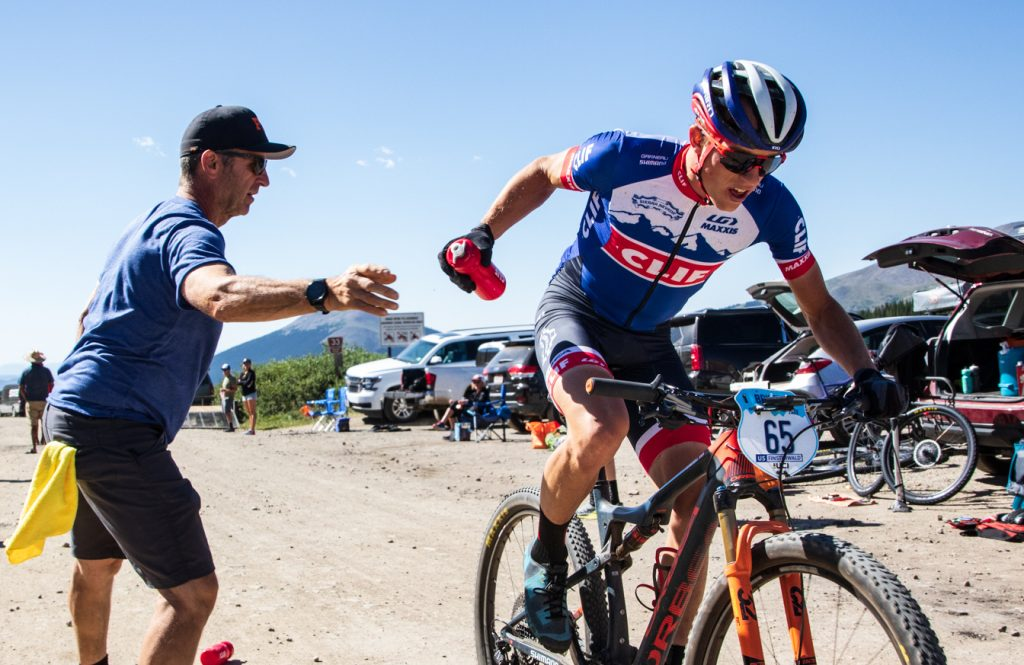 Russell Finsterwald rides through an aid station during Friday's final stage of the six-day Breck Epic mountain bike race. Finsterwald won the stage to finish runner-up in the Union Cycliste International elite men's division.