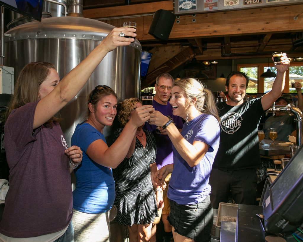 The owners and staff of Breckenridge Brewery and Pub celebrate on Wednesday, Aug. 28, with a newly-tapped imperial stout after news of a settlement deal with their landlord. The establishment is going to remain at its original location until May of 2021.