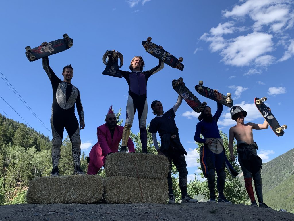 The podium rejoices after Sunday's Devil's Peak Downhill skateboarding event at Guanella Pass in Georgetown.