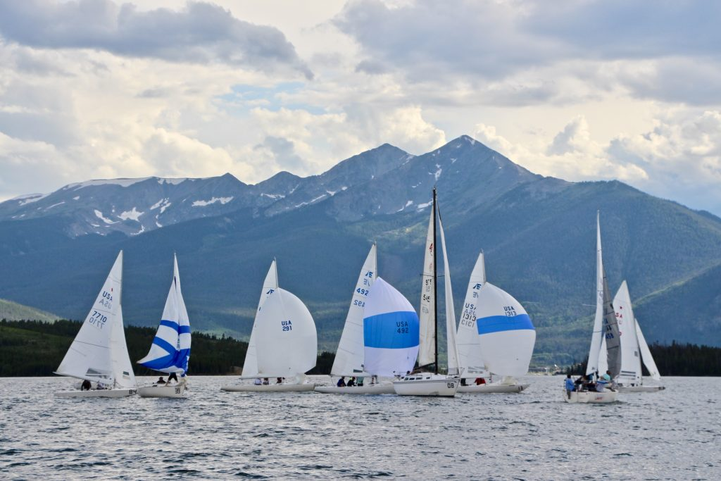 Sailboats racing in the Etchells fleet put up their spinnakers for a downwind leg of racing on Saturday as part of the 2019 Dillon Open on Lake Dillon.