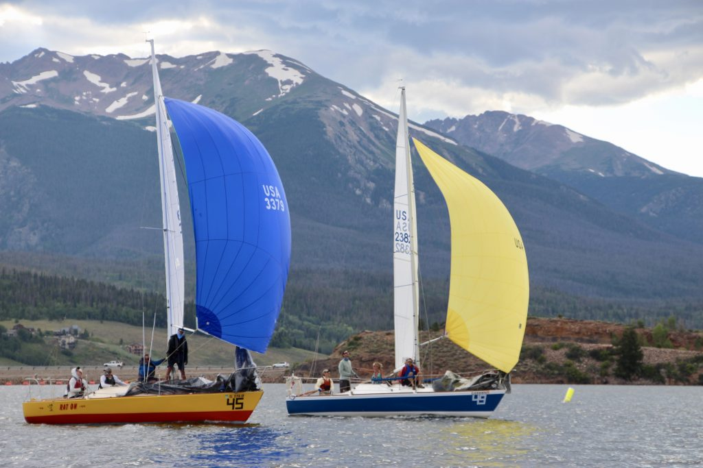 The Event Horizon boat, right, leads a group of J-24 sail boats in putting their spinnakers up to head downwind during Saturday's 2019 Dillon Open.