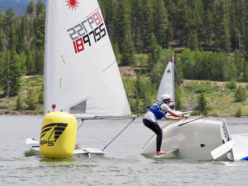 A member of Community Sailing of Colorado competing in the Laser Radial division rights his boat during Saturday racing as part of the 2019 Dillon Open on Lake Dillon.