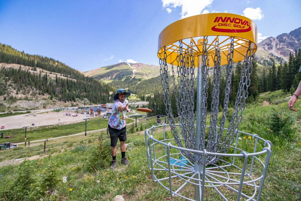 An athlete aims for the basket during this past weekend's inaugural Arapahoe Basin Alpine Open of disc golf at Arapahoe Basin Ski Area.