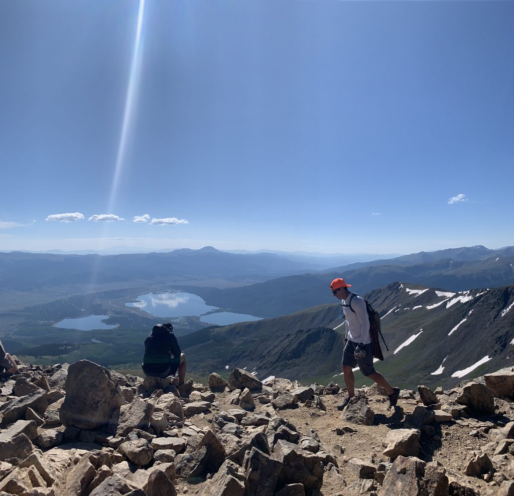 The view toward the southeast from the 14,440-foot summit of Mount Elbert provides views of Twin Lakes in the forefront and Pikes Peak on the hazy horizon line.