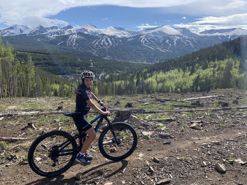 Samantha Bertolina poses for a picture while mountain biking.