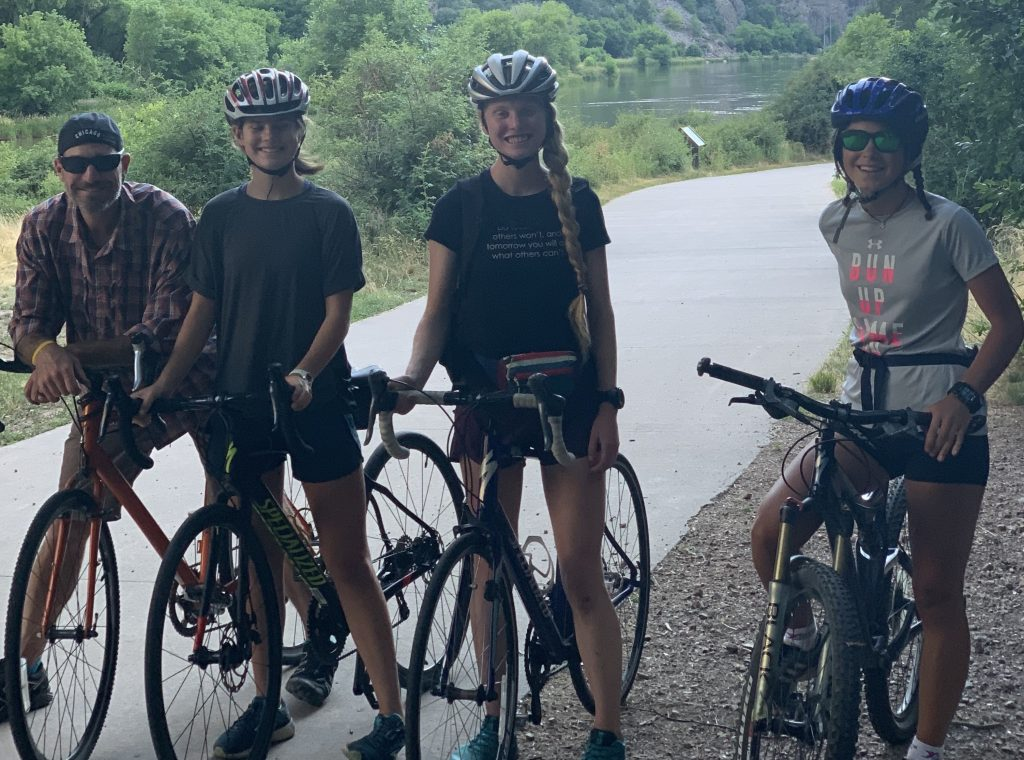 Grace Staberg, second from right, Samantha Bertolina, far right, and friends pose for a picture during road biking to and from Hanging Lake earlier this summer.