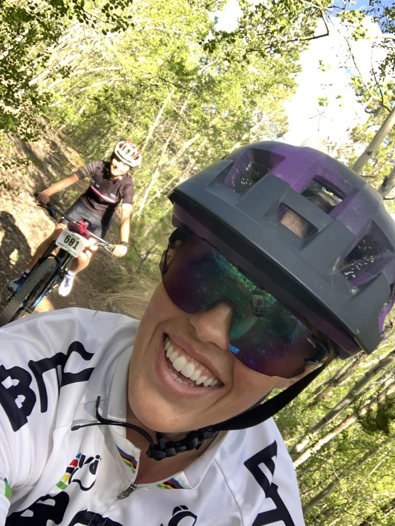 Summit local Sierra Anderson takes a selfie while mountain biking with Samantha Bertolina, background, earlier this summer.