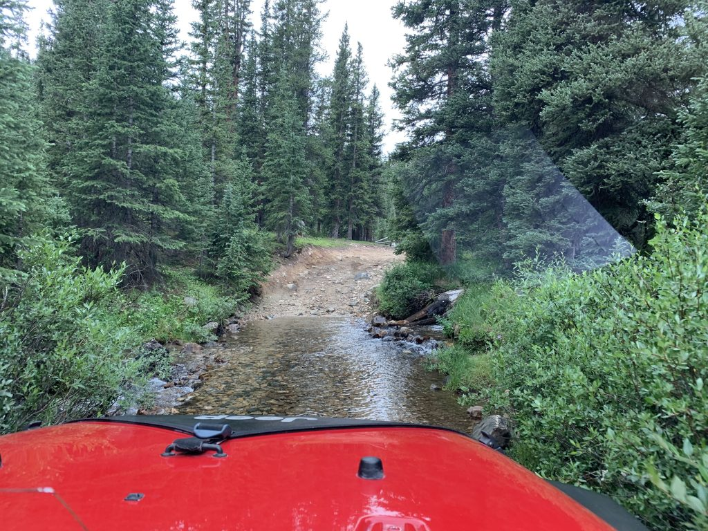 Riding through some lingering runoff below tree line during a Jeep trip on the Saints John route on Aug. 10