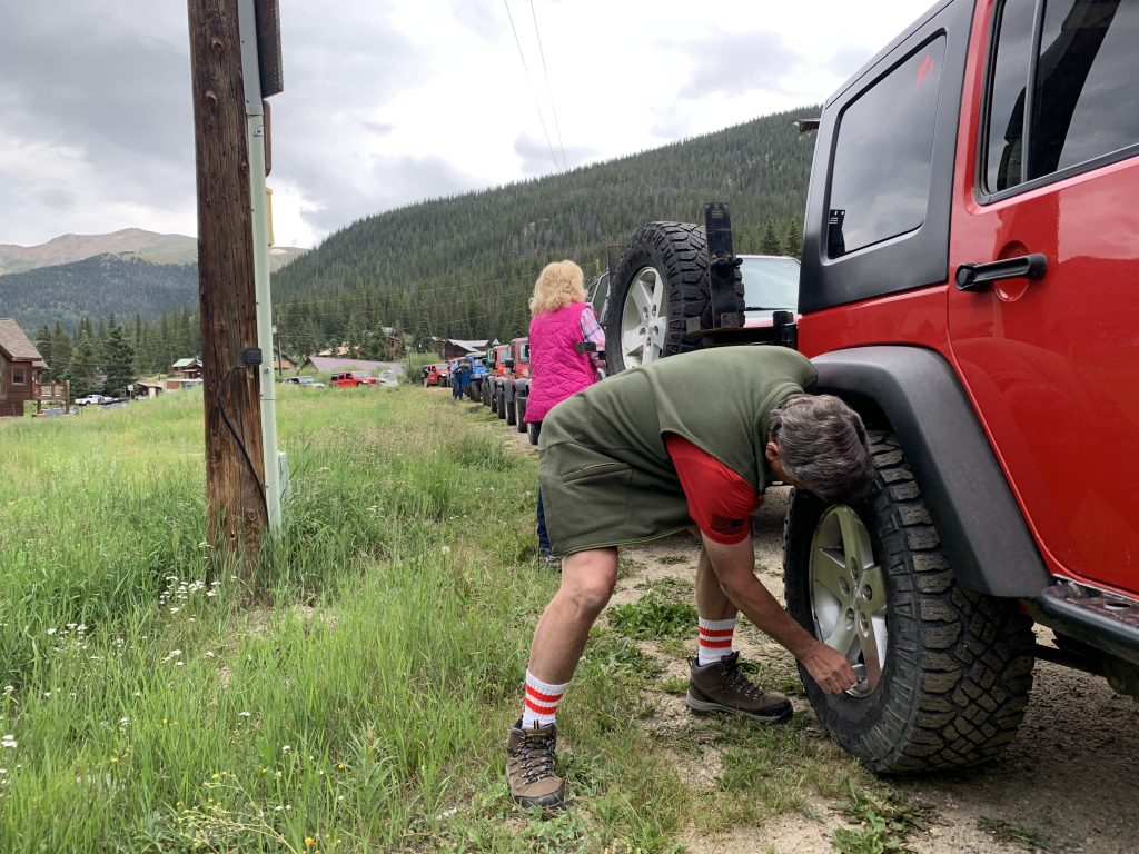 Bob Pietrzyk of the Dillon Community Church Jeep Club airs down his tires at the head of a line of about 15 Jeeps before riding the Saints John route on Aug. 10.