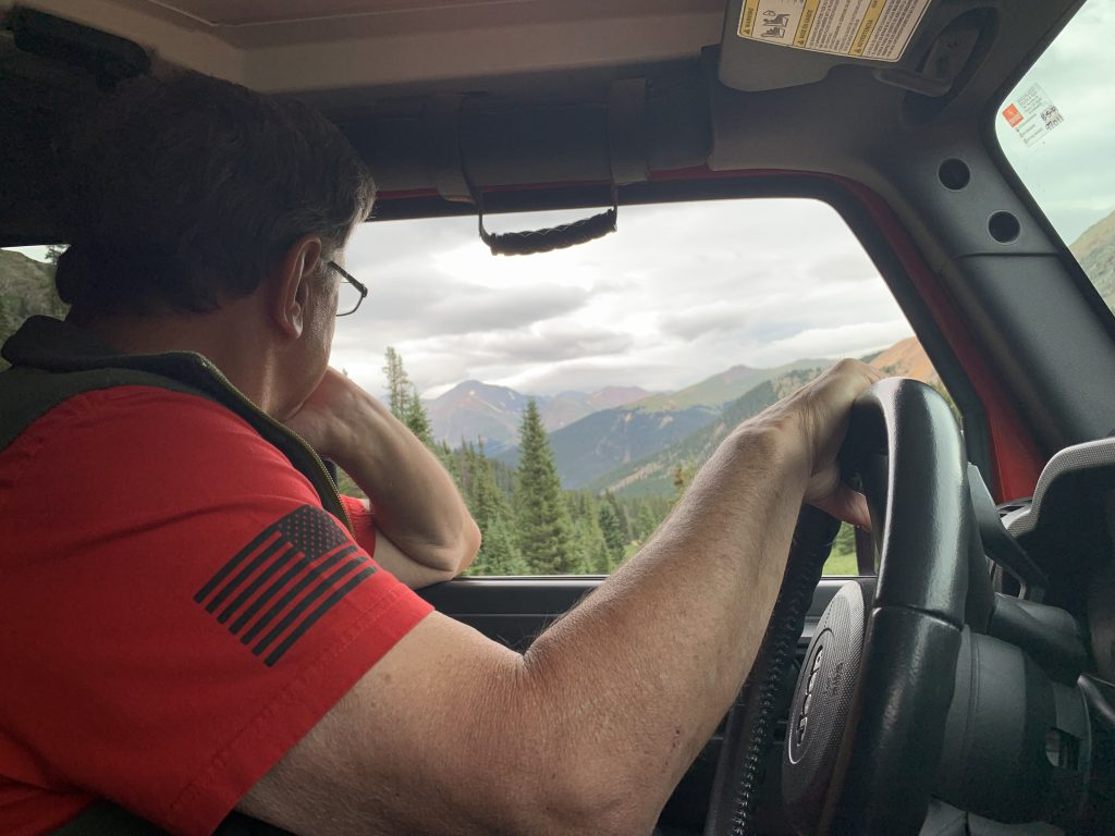 Bob Pietrzyk of the Dillon Community Church Jeep Club looks out from his Rubicon while riding the Saints John route on Aug. 10.