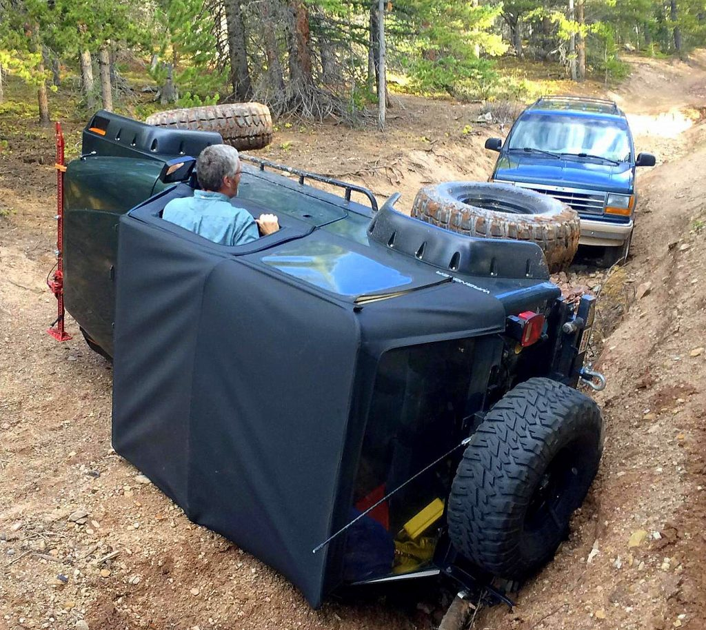 Pastor Jim Howard pokes his head up like a whack-a-mole from his 1993 YJ Jeep after flipping it on its side during a Dillon Community Church Jeep club outing.