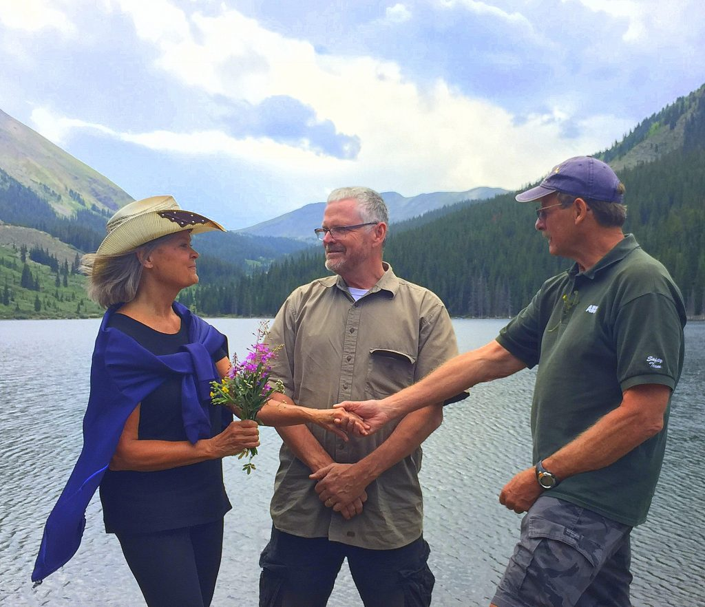 Pastor Jim Howard marries a couple in impromptu fashion at Mirror Lake near Tin Cup Pass south of Buena Vista during a Dillon Community Jeep Club trip last July.