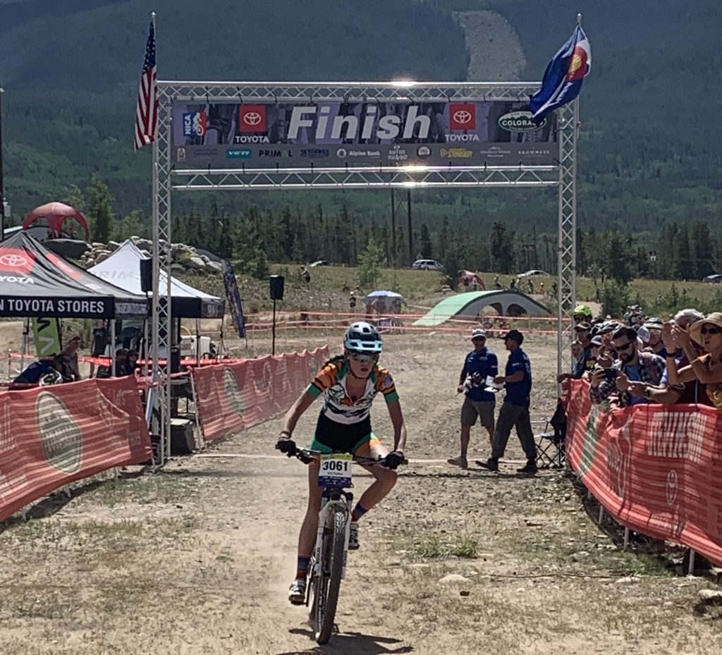 Victoria Uglyar of Summit High crosses the finish line during Sunday's first meet of the 2019 Colorado High School Cycling League mountain bike season, the Frisco Bay Invitational at the Frisco Peninsula.