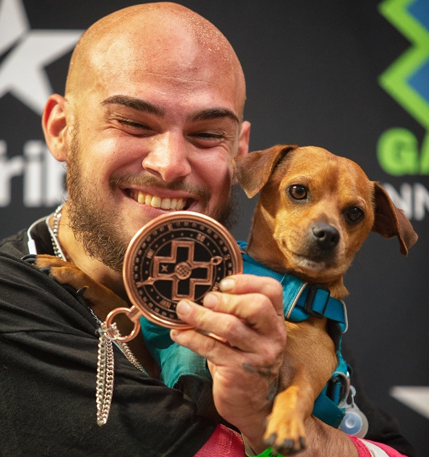 Frisco resident Mike Minor smiles after receiving his bronze medal Saturday evening in Minneapolis at the inaugural X Games adaptive skateboard park competition.