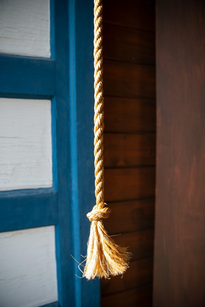 "A detail of the rope of the bell at the historic one-room schoolhouse in Dillon, Colo. The bell was rung on Thursday, Aug. 22, by local historian and ""school-marm"" Christy Nelson who is the education coordinator at the Summit Historical Society."