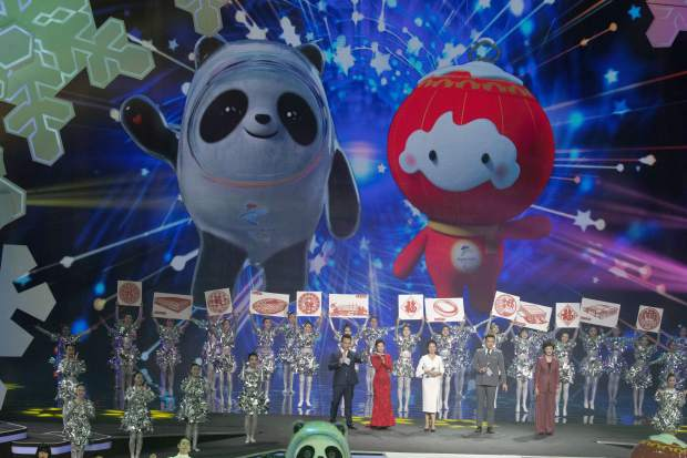 Beijing 2022 Winter Olympic Mascot Bing Dwen Dwen, left and 2022 Winter Paralympic Games mascot Shuey Rong Rong are revealed during a ceremony held at the Shougang Ice Hockey Arena in Beijing on Tuesday.