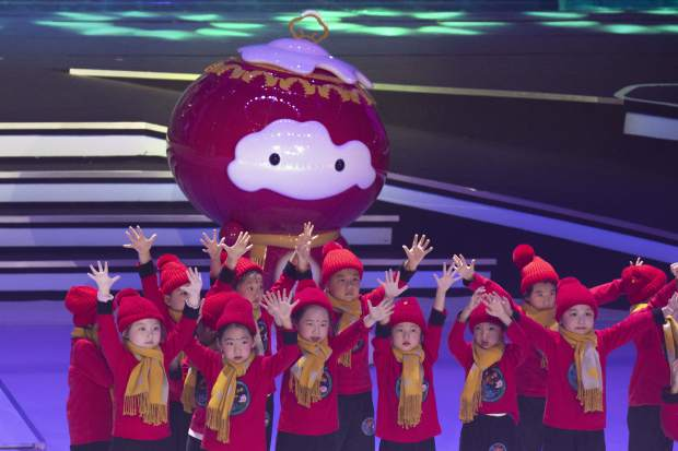 Children perform near the 2022 Winter Paralympic Games mascot Shuey Rong Rong during a ceremony held at the Shougang Ice Hockey Arena in Beijing on Tuesday.
