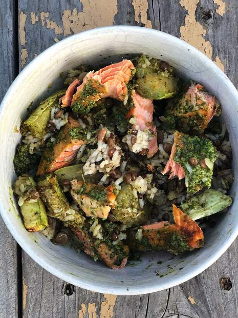 Pesto salmon zucchini rice bowl.