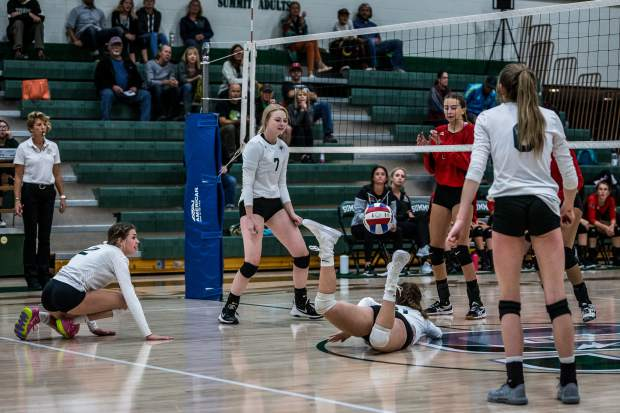 Mackenzie Westenskow dives for the ball as Summit High plays Aspen in varsity volleyball at Summit High in Breckenridge on Tuesday, Sept. 17. Summit won all three sets against Aspen.