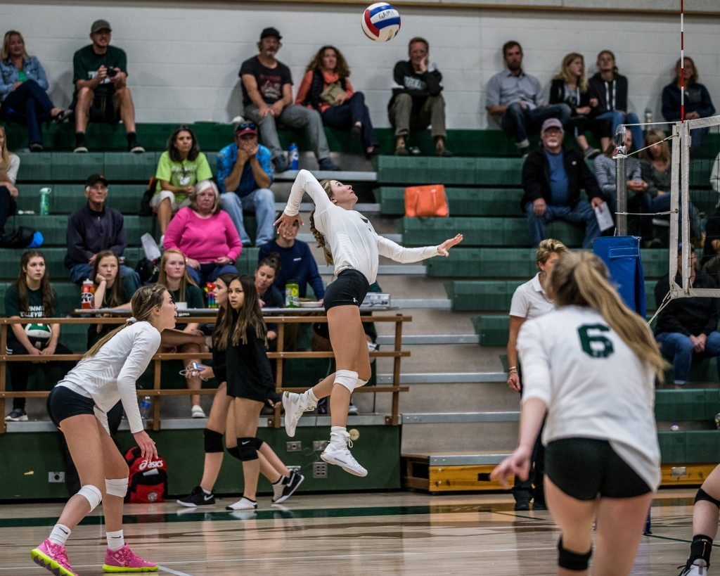 CJ Novotna jumps to return a volley as Summit High plays Aspen in varsity volleyball at Summit High in Breckenridge, Colo. on Tuesday. Summit won all three sets against Aspen.