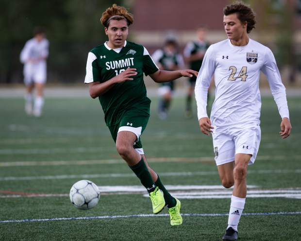 Brandon Lopez (10) takes the ball past Harrison Rubis (24) during the first half of the game versus Battle Mountain at Summit High in Breckenridge on Tuesday, Sept. 17. The Tigers fell to the Battle Mountain Huskies 5-0.