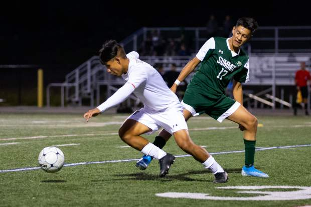 Summit High midfielder Alex Casillas (17) defends during the second half of the Tigers' home game versus Battle Mountain at Summit High in Breckenridge on Tuesday. The Tigers on Saturday won their first game of the season on the road versus Palisade.