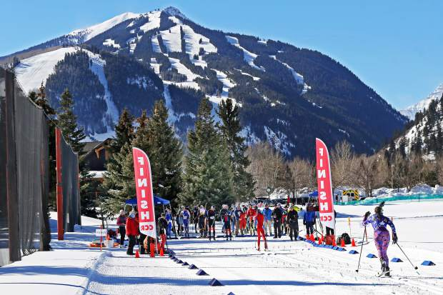A racer approaches the finish of the Owl Creek Chase cross-country ski race at the Aspen Nordic Center.