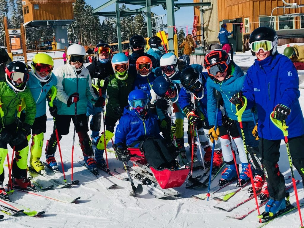 Burke Ryder surrounded by his teammates from Team Breckenridge Sports Club.