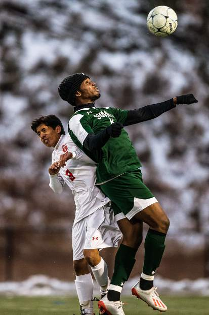 Steamboat's Alfredo Perez (9) and Summit's Maschelle Kepple (8) go head to head in the first half of the game at Summit High in Breckenridge on Tuesday, Oct. 22. Summit fell to Steamboat 5-4 in a snowy double overtime game.