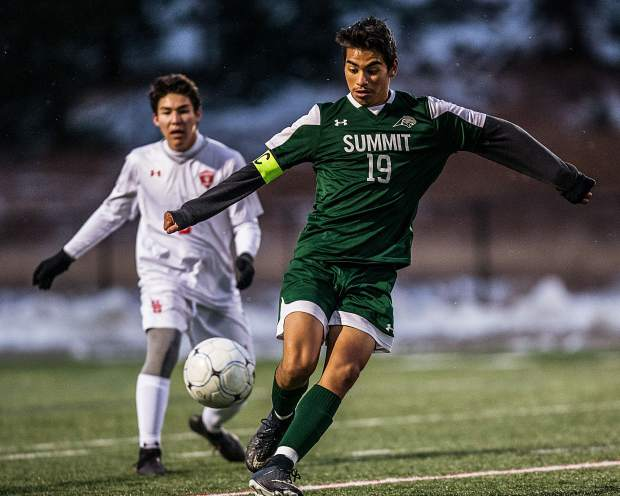 Ivan Gutierrez (19) powers the ball down the field in the first half of the game against the Sailors at Summit High in Breckenridge on Tuesday, Oct. 22. Summit fell to Steamboat 5-4 in a snowy double overtime game.