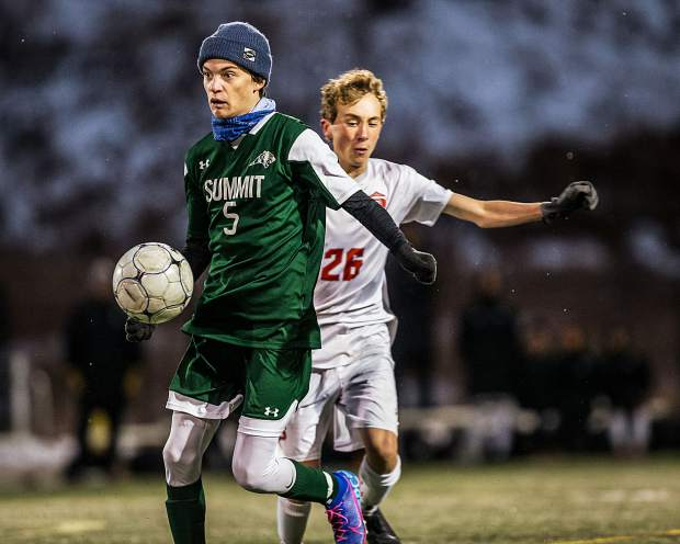 Gannon Heisler (5) moves the ball past Steamboat's Henry Cardillo (26) at Summit High School in Breckenridge on Tuesday, Oct. 22.