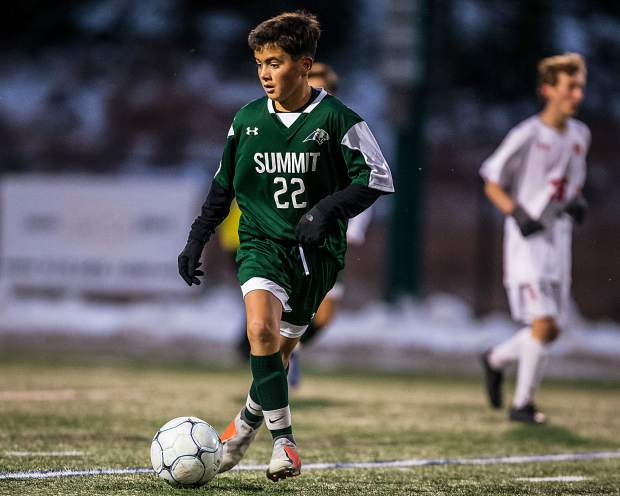 Owen Gallo maneuvers the ball around Steamboat's defense to score in the first half of the game at Summit High School in Breckenridge on Tuesday, Oct. 22.